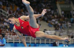 Marian Dragulescu of Romania performs on the floor 18 August 2004 at the Olympic Indoor Hall during the men's artistic gymnastics individual all-around …