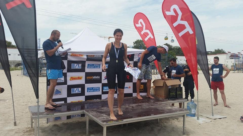 Dupa o cursă de înot de 5.000 de m, pe podium; foto credit arhiva personala